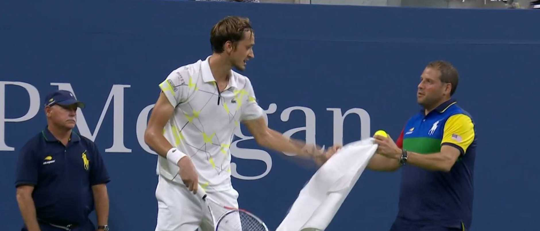 Medvedev rips a towel away from a ball boy earlier in the tournament.