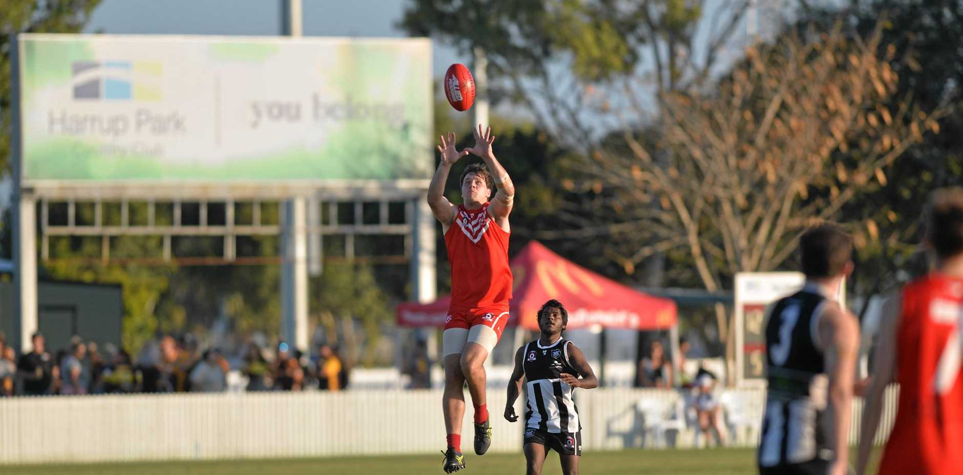 TAKING FLIGHT: Eastern Swans' Luke Ball leaps to take an overhead mark in the preliminary final against Mackay Magpies.