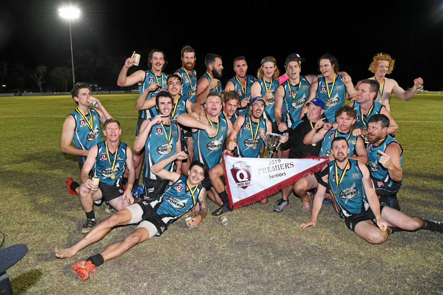 PREMIERS: Bay Power celebrates their historic premiership win over the Hervey Bay Bombers on Saturday night.