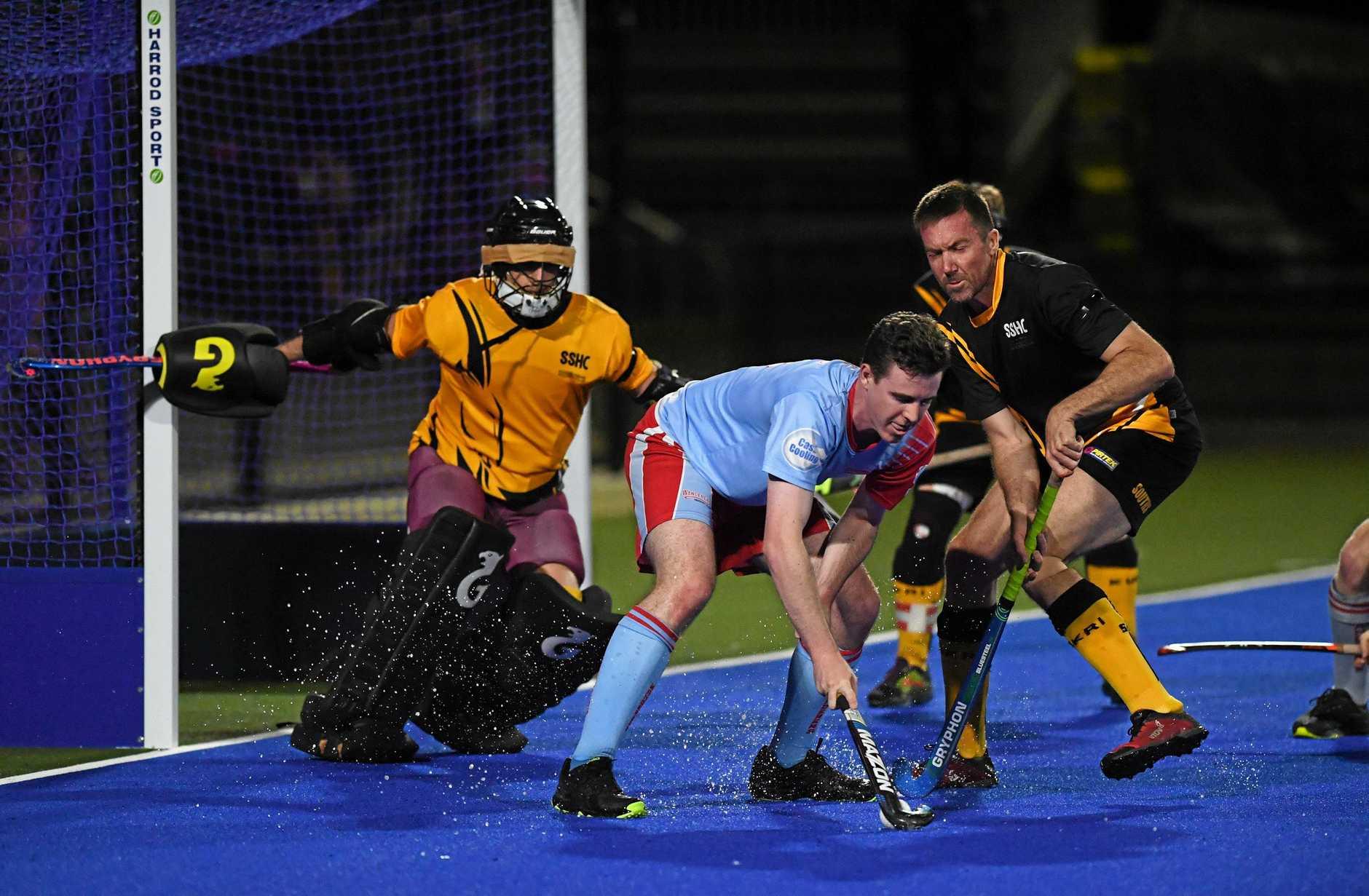 Hockey, Wanderers Brayden McKay shoots at Souths goalie Matt Olive