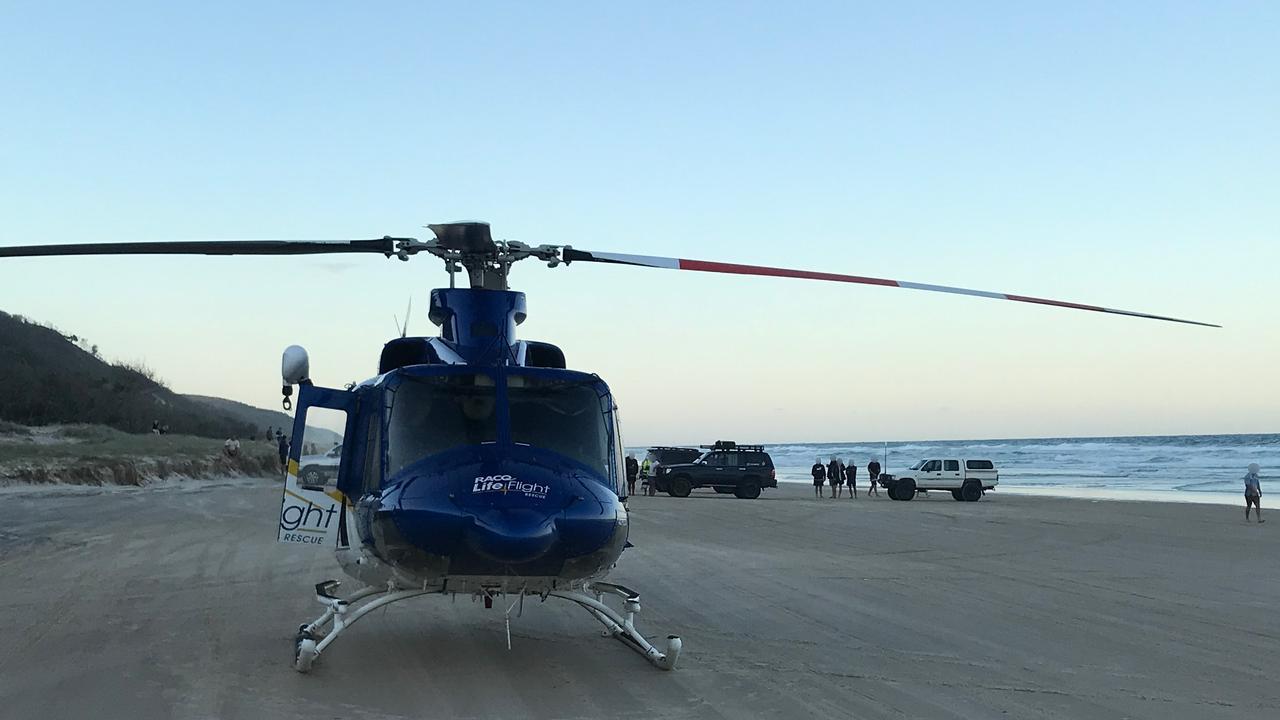 The RACQ LifeFlight Rescue chopper lands on the beach. Picture: Courtesy RACQ LifeFlight Rescue