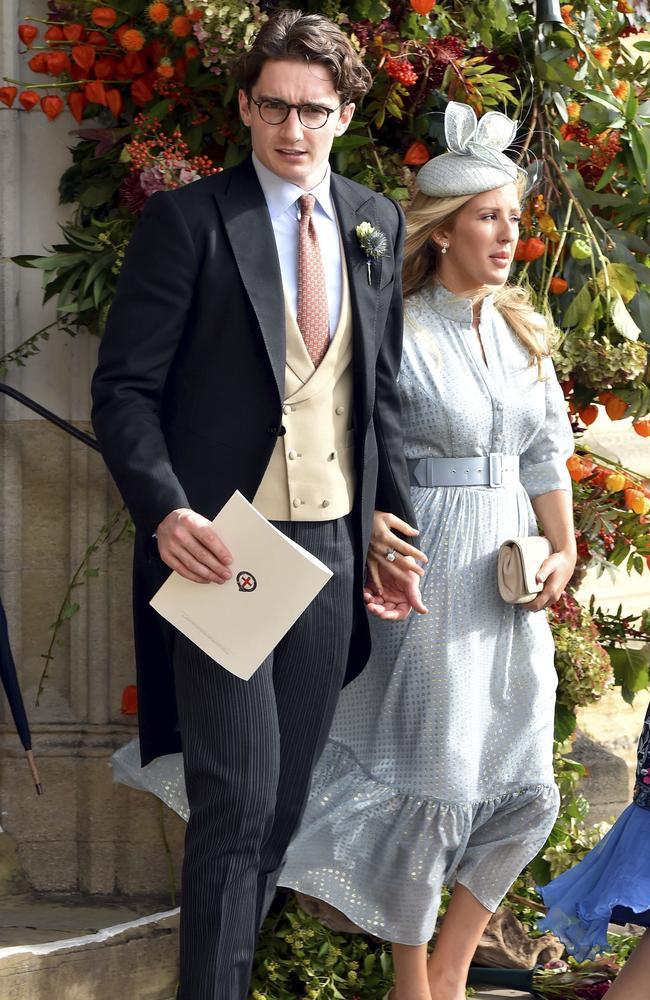Caspar Jopling, left, and singer Ellie Goulding depart after the wedding of Princess Eugenie of York and Jack Brooksbank in October 2018. Picture: AP