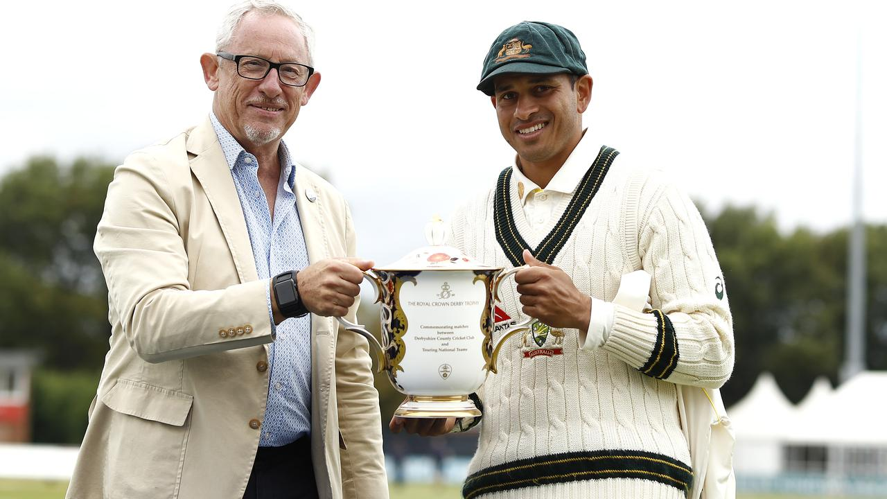 Usman Khawaja of Australia is presented with the winners trophy during day three of the Tour Match between Derbyshire CCC and Australia. Picture: Ryan Pierse/Getty Images