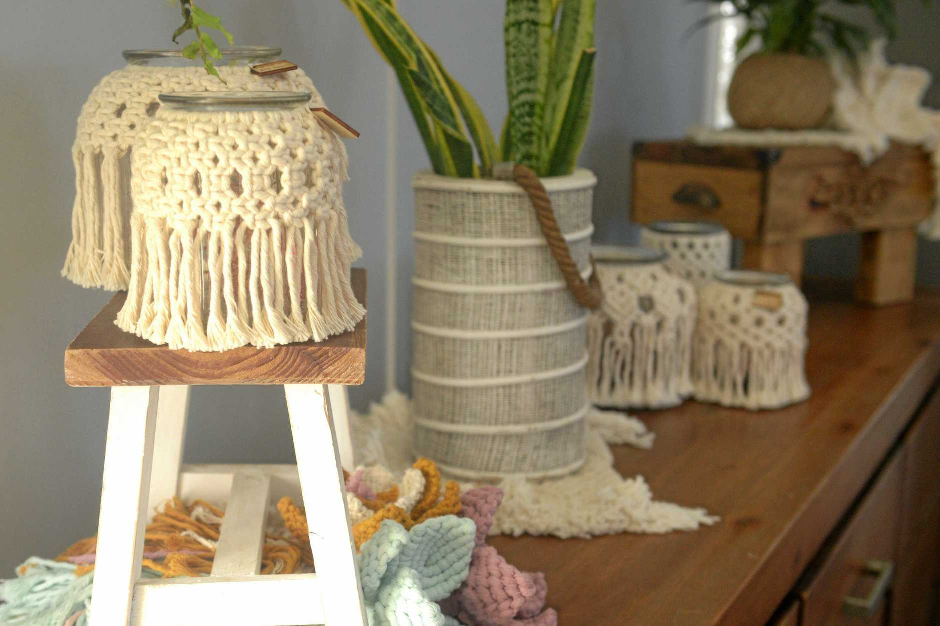Neutral candle and jar holders with macrame.