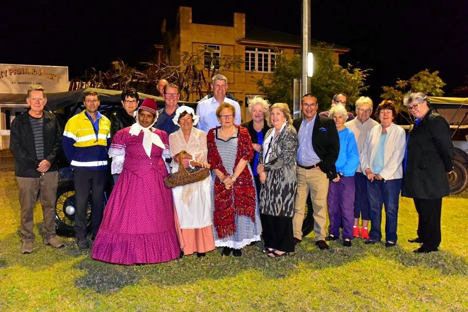 LIGHTS ON: Government officials and volunteers celebrate turning on the lights at the Heritage Village on Monday.