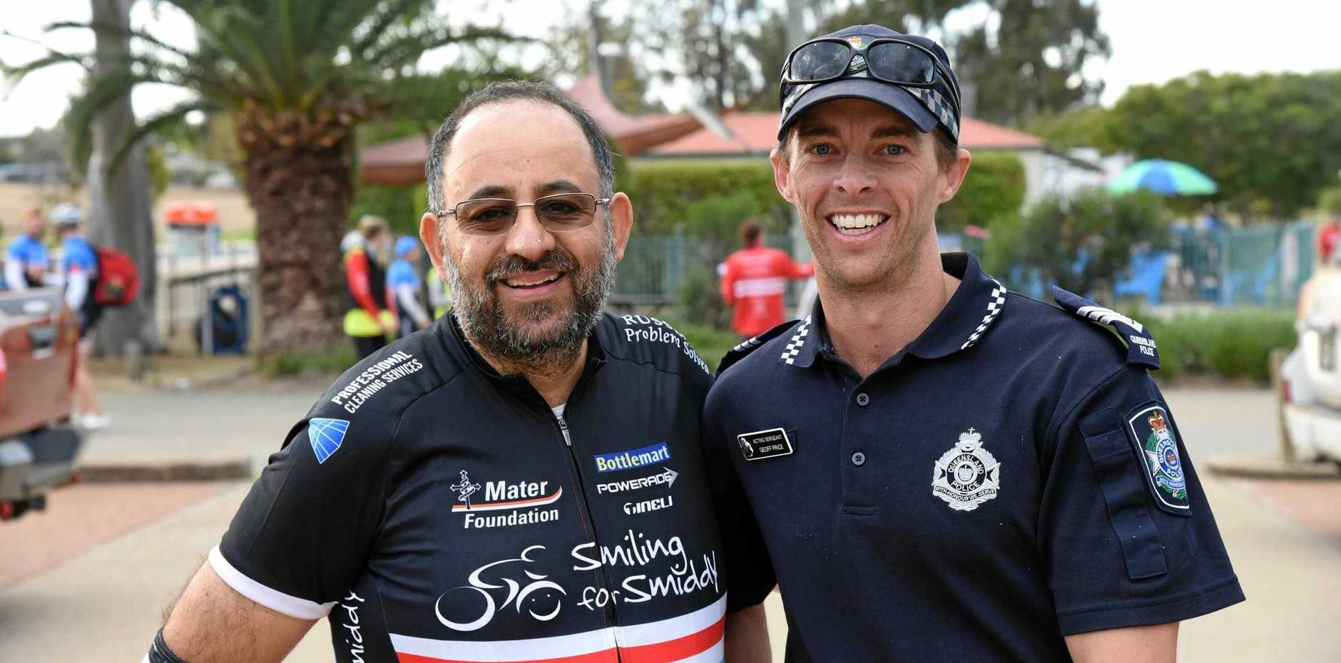 Visht Singh and acting sergeant Geoff Price at the 14th annual 1600km Bottlemart Smiling for Smiddy Challenge as it passed through Mundubbera on Thursday, August 29.