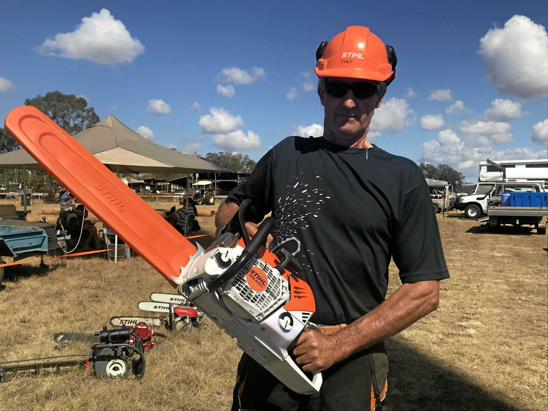 STILL KICKING: Trevor Baker had a close call in the Chainsaw Racing at the Wondai Show.