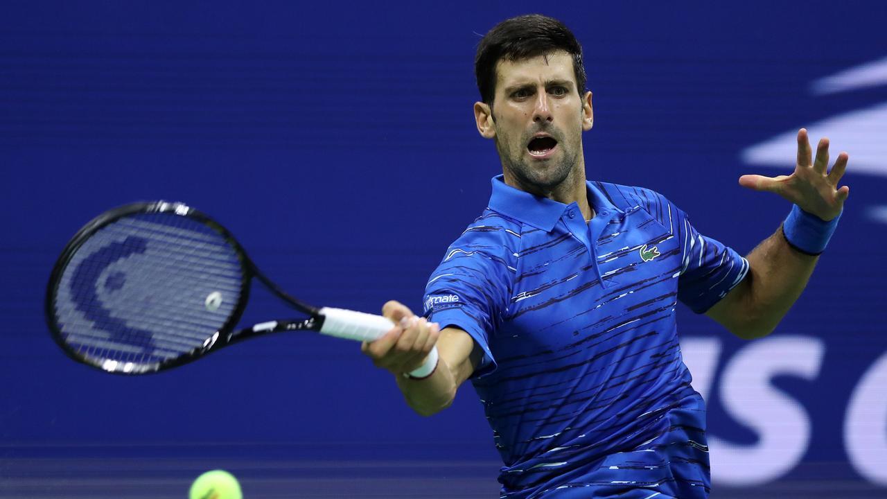 Novak Djokovicreturns a shot against Stan Wawrinka. (Photo by Matthew Stockman/Getty Images)