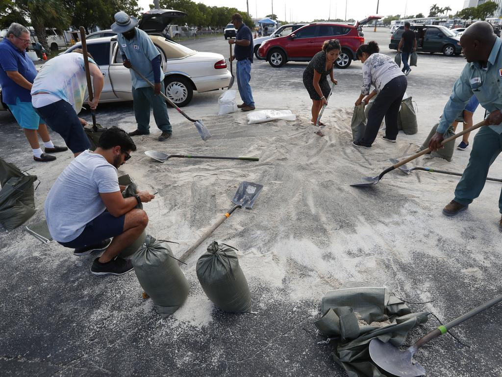 Residents fill up sandbags with the last bits of sand available in preparation for Hurricane Dorian in Hallandale Beach