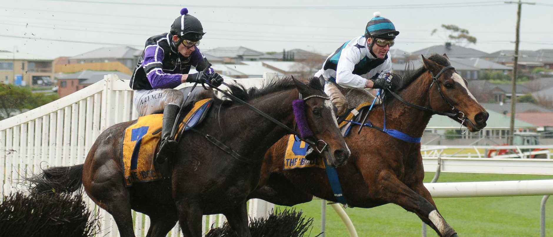 Jockey Paul Hamblin (right) clears the final hurdle on Hornets' Nest in the Lafferty Hurdle at Warrnambool in 2017. Picture: Getty Images