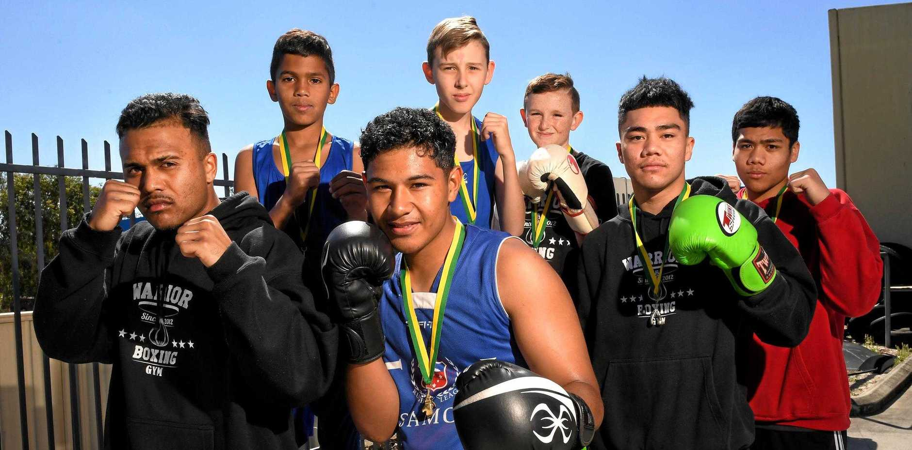 ON THE RISE: The Warrior Boxing team Justen Rana, Ryan Ropati, Connor Fatialofa, Yandall Fatialofa and (back row) Nathanael Bonner, Oscar Black and Noah Stewart had a successful Golden Gloves tournament.