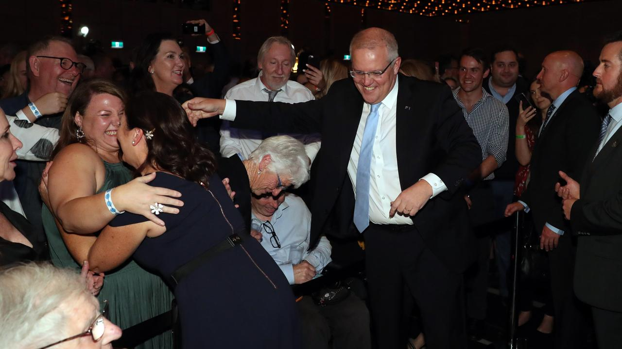 Scott Morrison and his wife Jenny celebrate his shock win at the Coalition's official Election Night function in Sydney. Picture: Gary Ramage