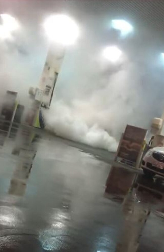 A driver performing a burnout at On The Run service station at Davoren Park.