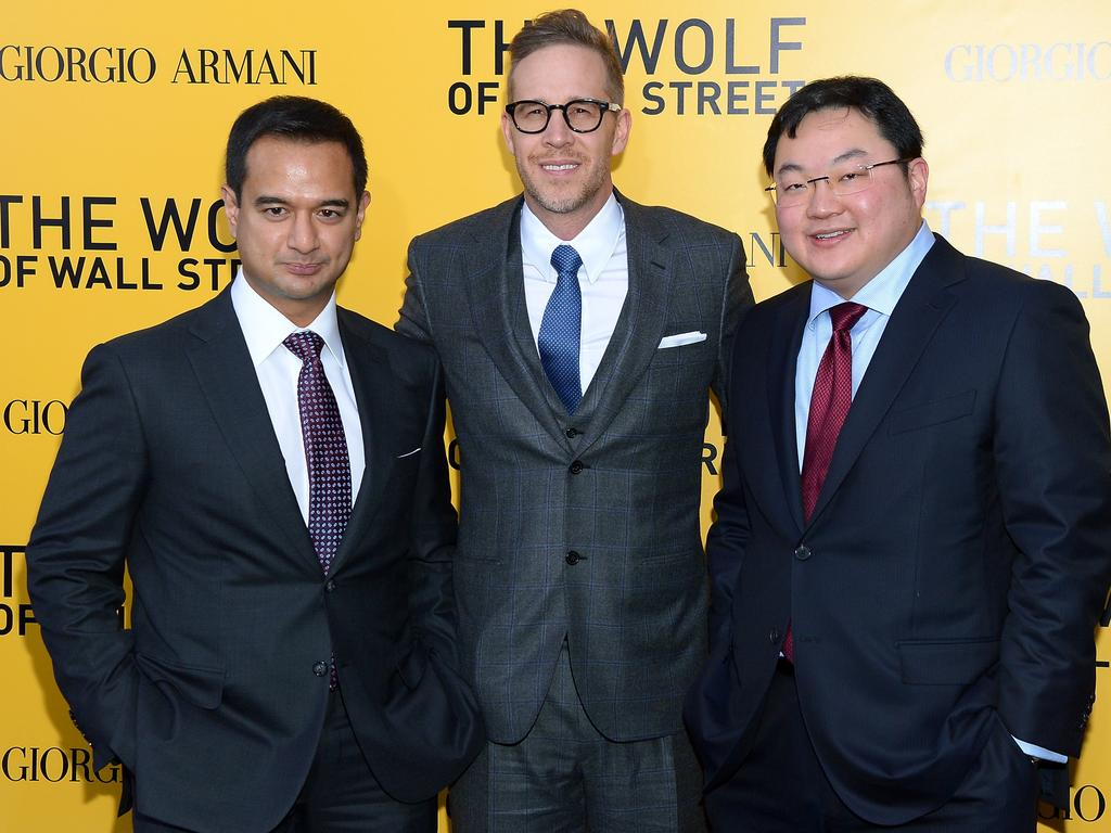 Jho Low (right) with Riza Aziz (left) and Joey McFarland at The Wolf Of Wall Street premiere in New York in 2013. Picture: Michael Loccisano