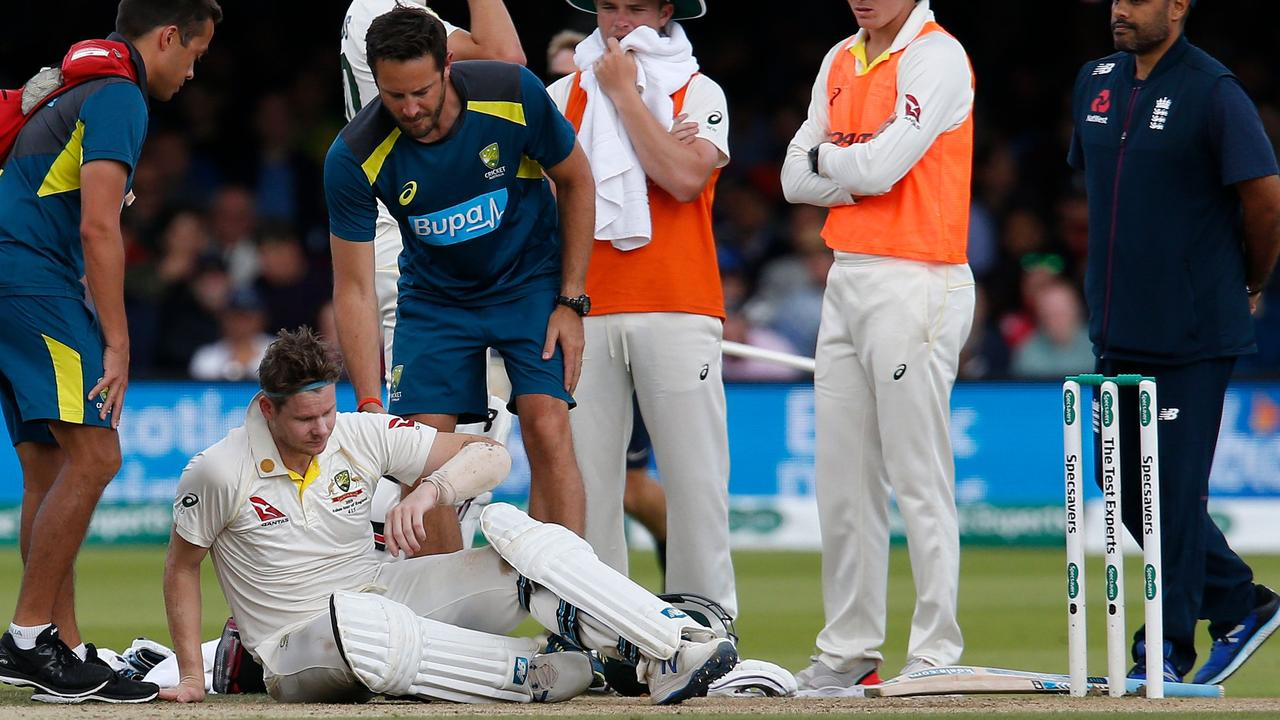 (FILES) In this file photo taken on August 17, 2019 Australia's Steve Smith lays on the pitch after being hit in the head