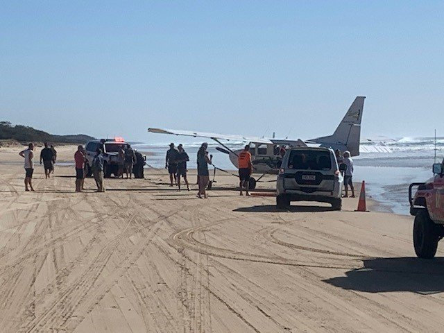 A plane had to be winched from the water after becoming bogged on Fraser Island.