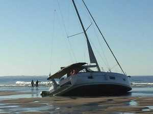 Luxury yacht stranded on Fraser Island beach