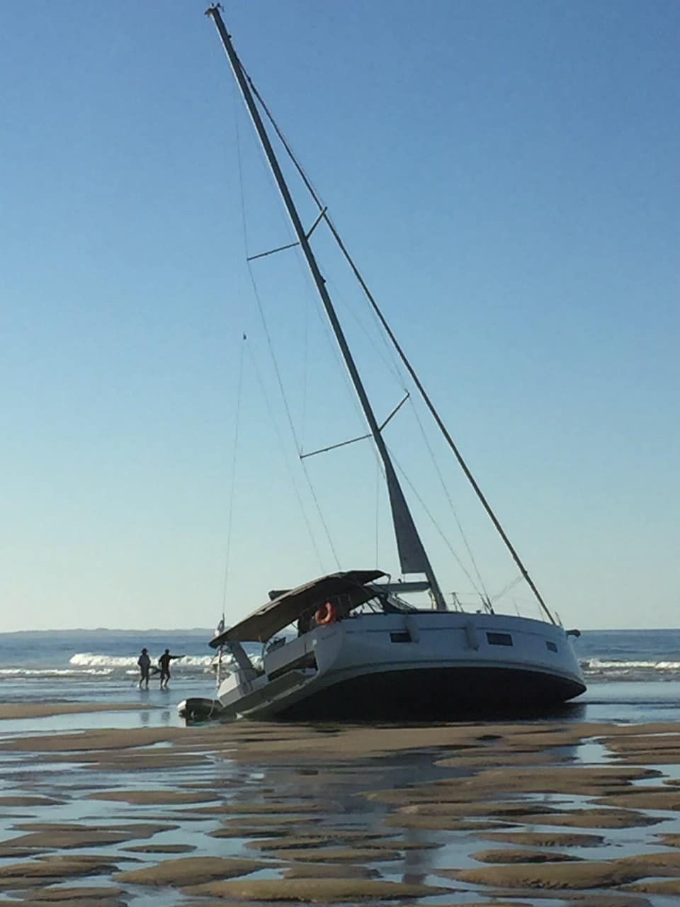 The luxury yacht that has washed up on a beach on Fraser Island.
