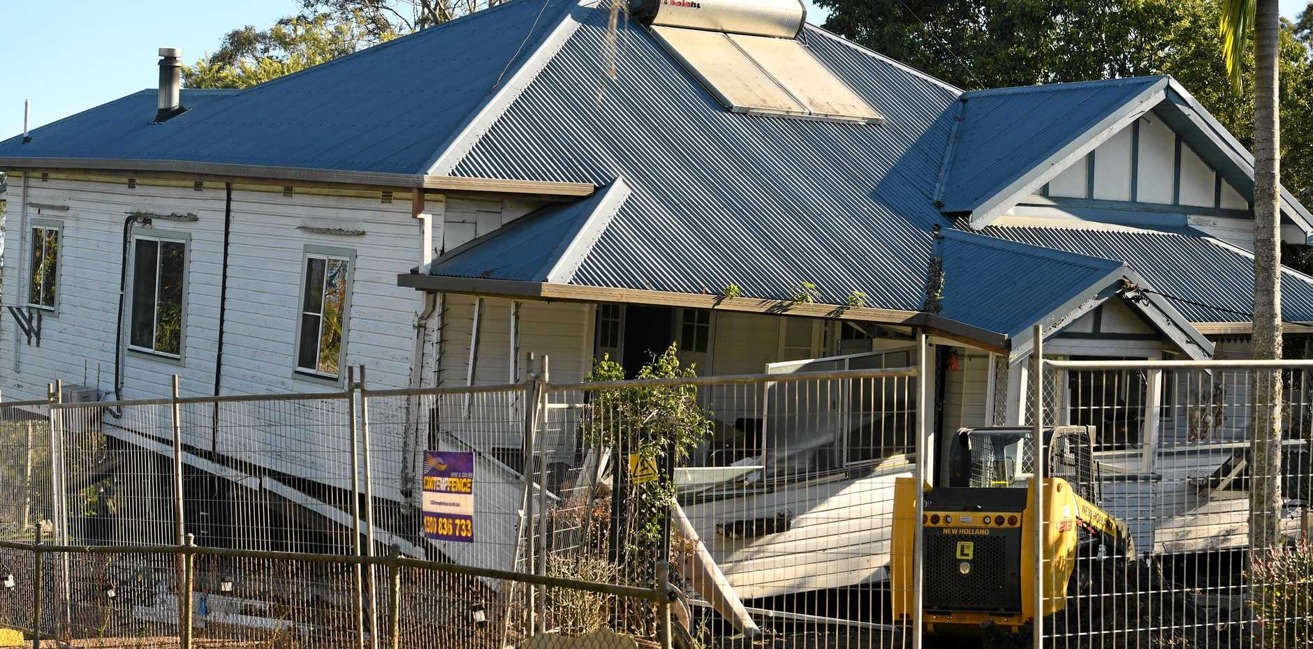 A house in South Lismore appears to have lost structural support and fallen.