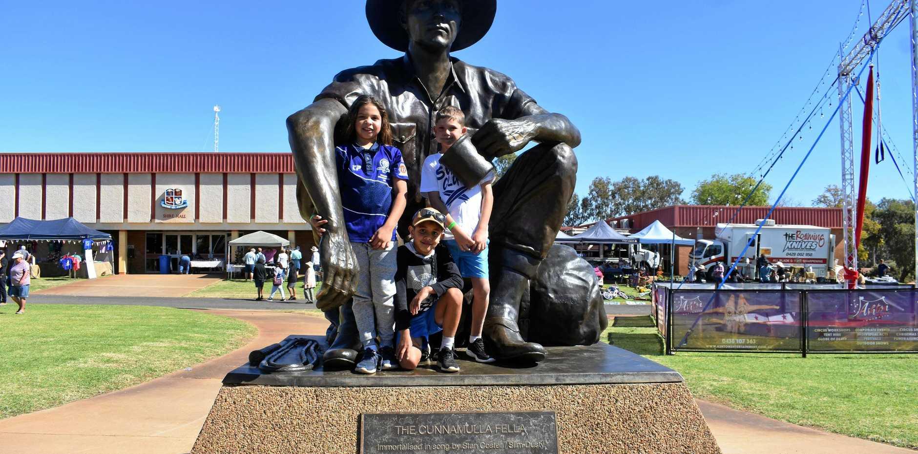 FESTIVAL FUN: Corey Maxwell, Kayden Munn and Paige Tanner on the Cunnamulla Fella statue.