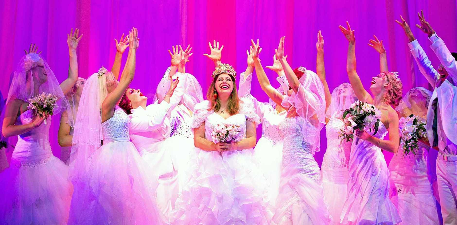 Natalie Abbott, centre, in a scene from Muriel's Wedding the Musical.