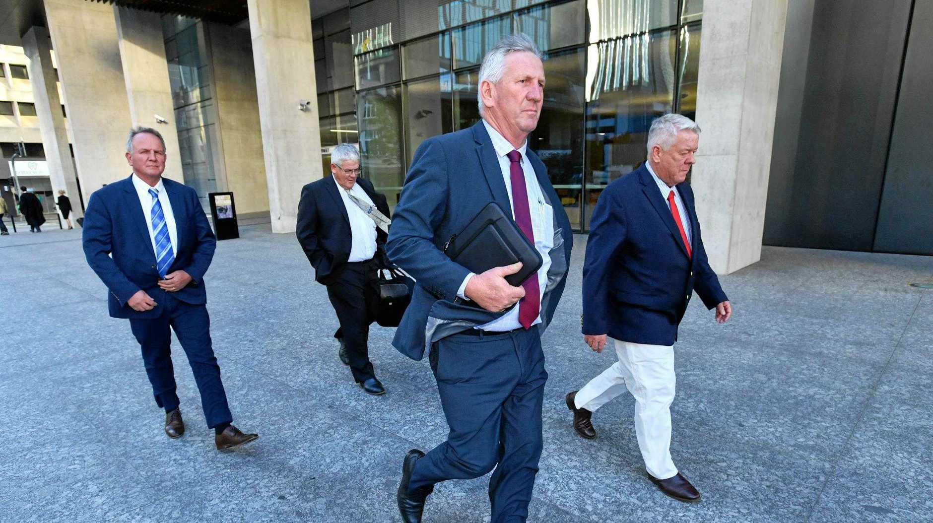 Toowoomba's Joe, Neill, Denis and John Wagner leave the Supreme Court in Brisbane.
