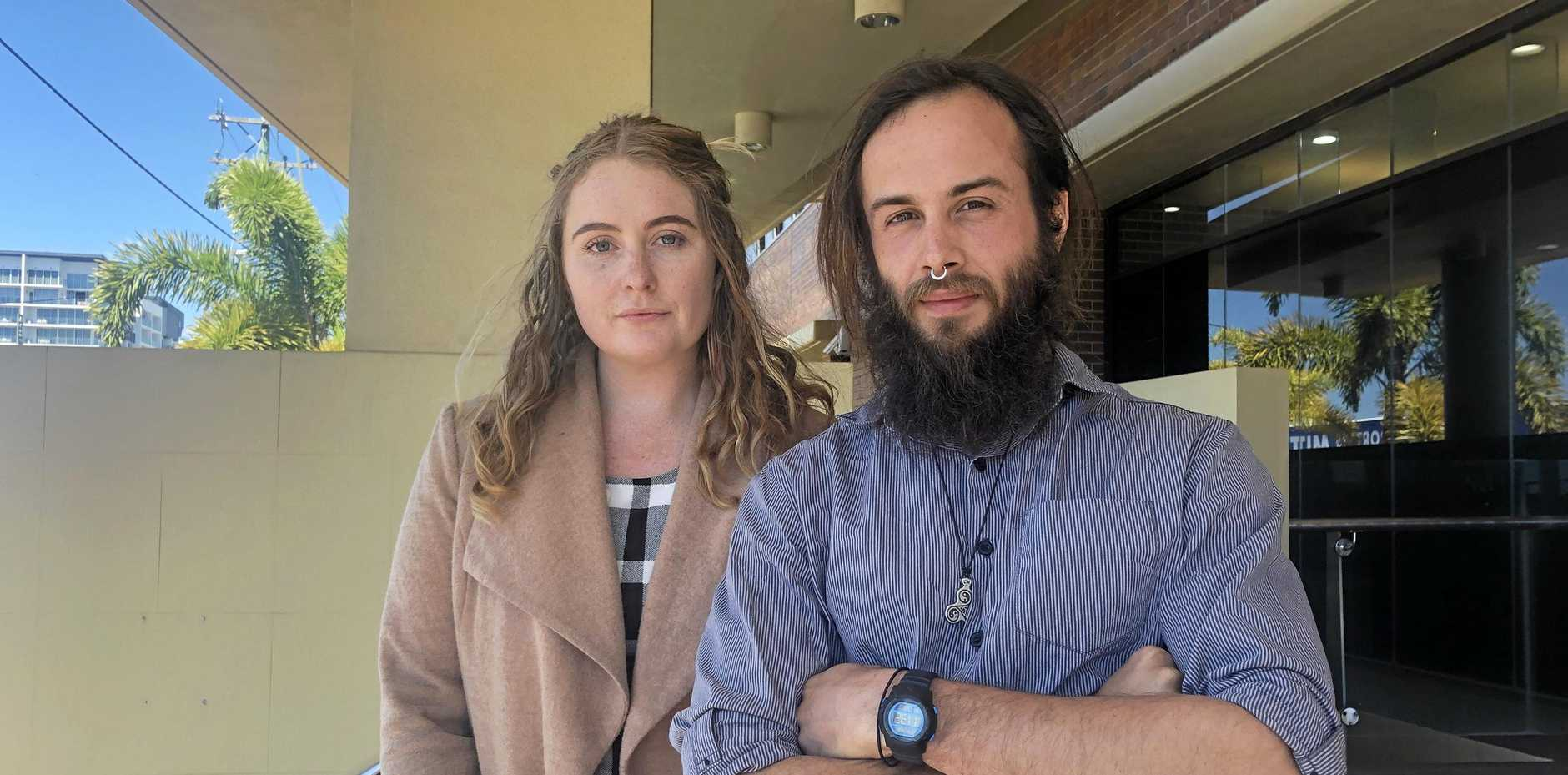 Amy Francis Booth, 25, and Reuben Michael Anstee, 28, are accused of causing more than $12,000 damage when they suspended themselves from poles at Adani's Carmichael mine site.