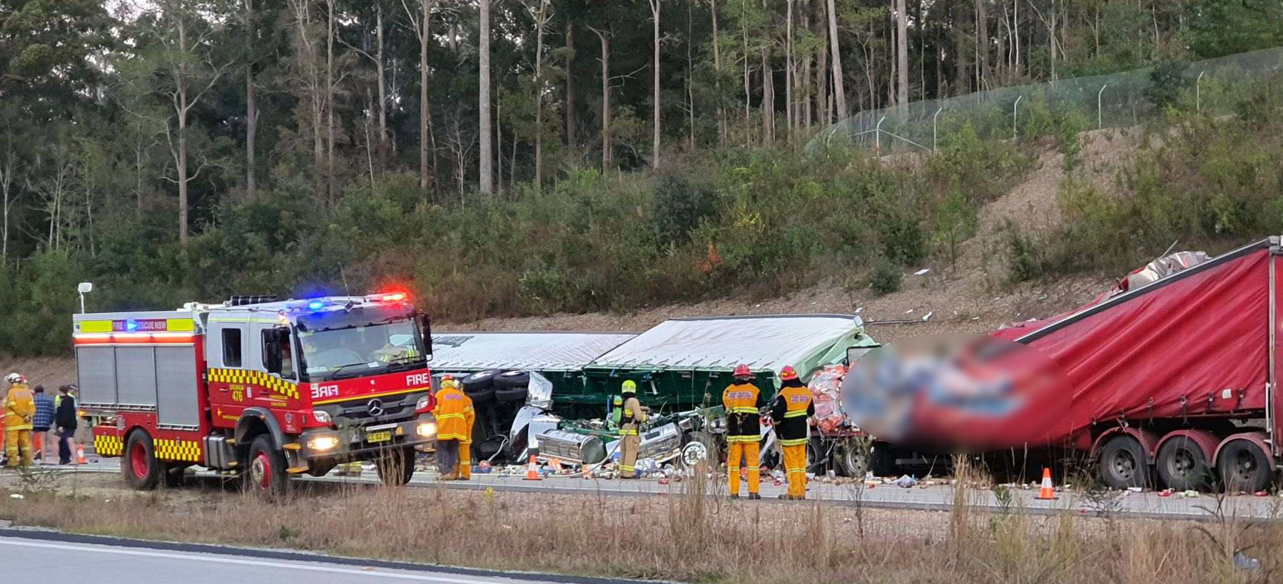 A driver has died in a crash on the Pacific Highway involving two trucks near Nambucca Heads.