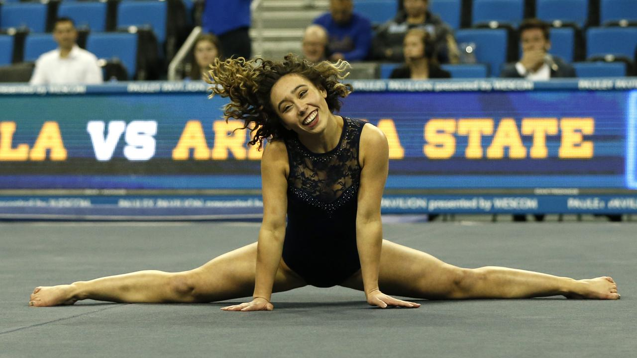 Katelyn Ohashi dazzles on the mat. (Photo by Katharine Lotze/Getty Images)