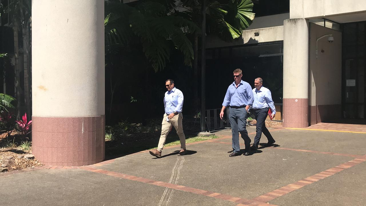 Queensland Health representatives leave court after Woolworths was convicted of breaching the Food Act.