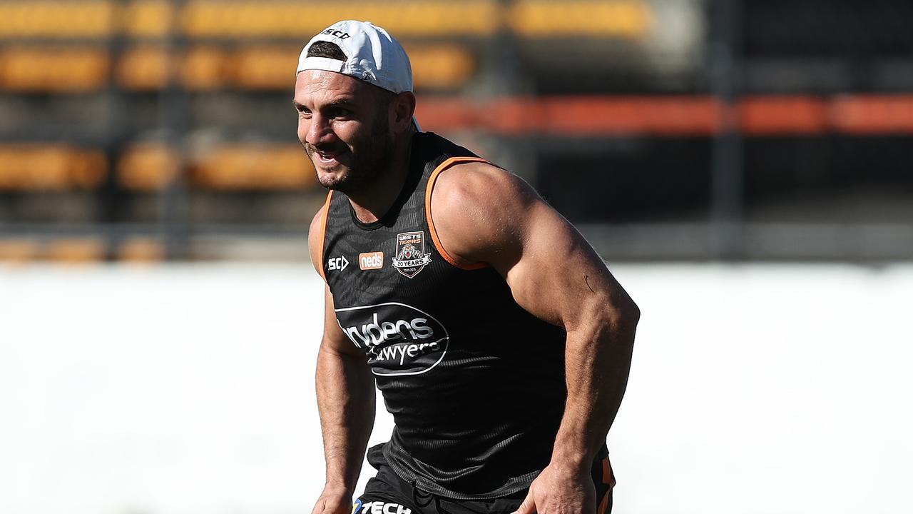 Robbie Farah runs on his injured leg during Wests Tigers NRL training at Leichhardt Oval, Sydney. Picture: Brett Costello