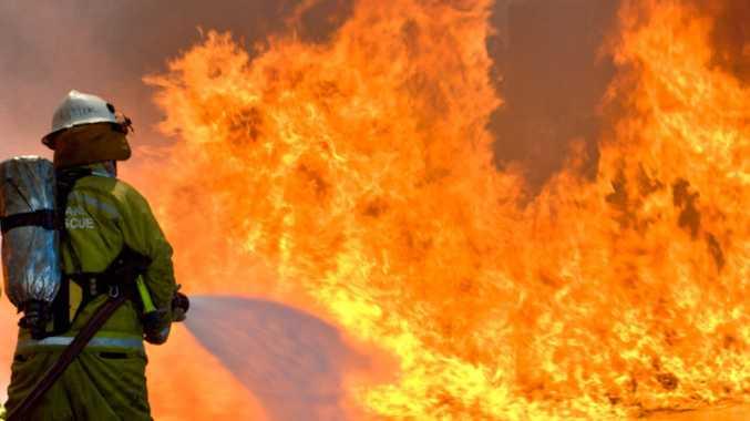 Crews working to contain Curtis Island bushfire