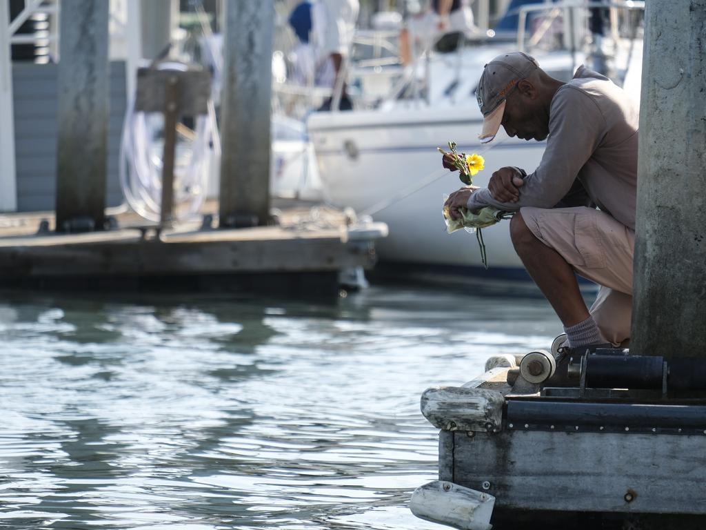 James Miranda of Santa Barbara takes a moment to reflect at a dock near the Sea Landing at Santa Barbara Harbour as hopes of finding survivors diminish. Picture: AP/Ringo H.W. Chiu