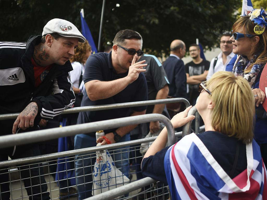 Pro-leave and Pro-remain protesters remonstrate with one another outside parliament on in London. Picture: Getty Images