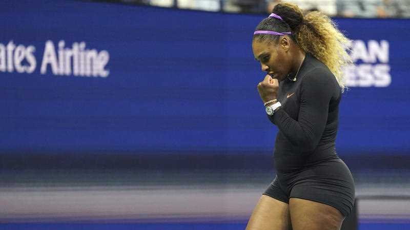 Serena Williams, of the United States, reacts during her match against Qiang Wang, of China.