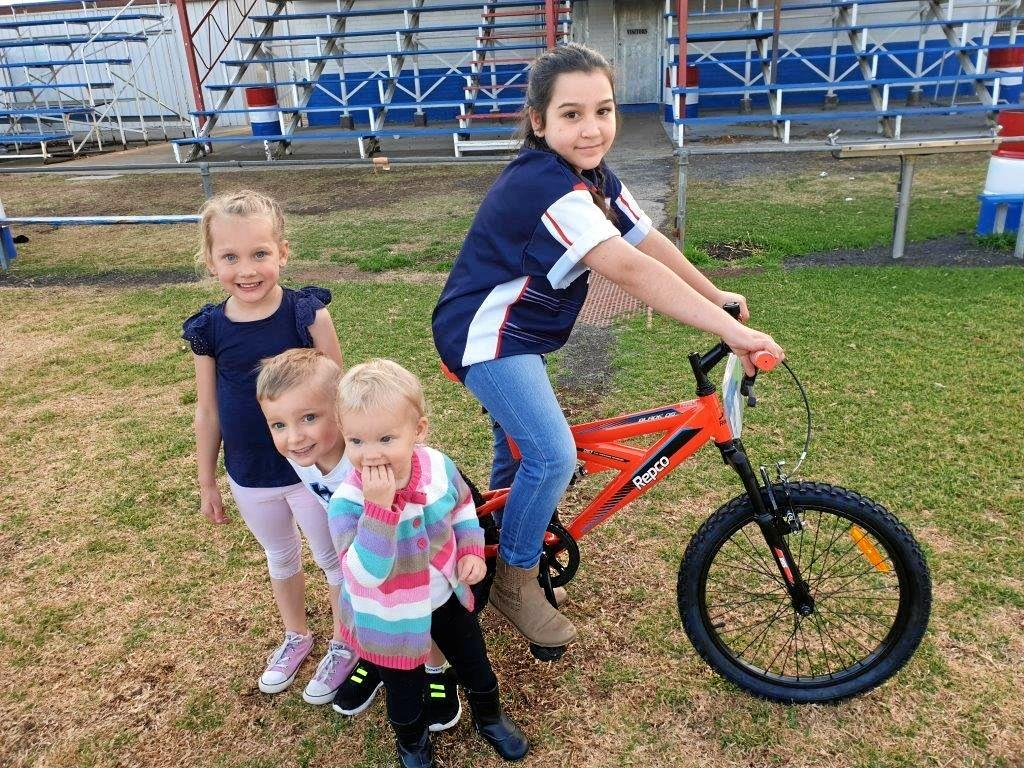 GREAT PRIZE: Tilly Bloomfield ready to ride with siblings (from left) Lani, Sonny and Isla, on the bike to be given away at the Warwick Cowboys Rodeo tomorrow night.