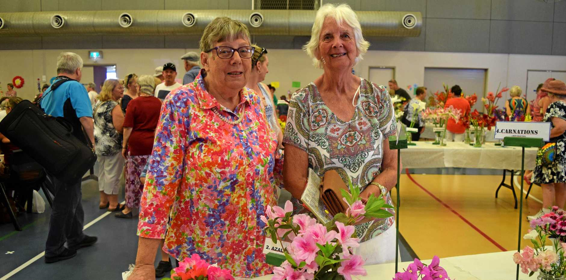 ON AGAIN: Ailsa Reinke and Irene Stephens browse the winning buds at last year's Proserpine Flower Show.