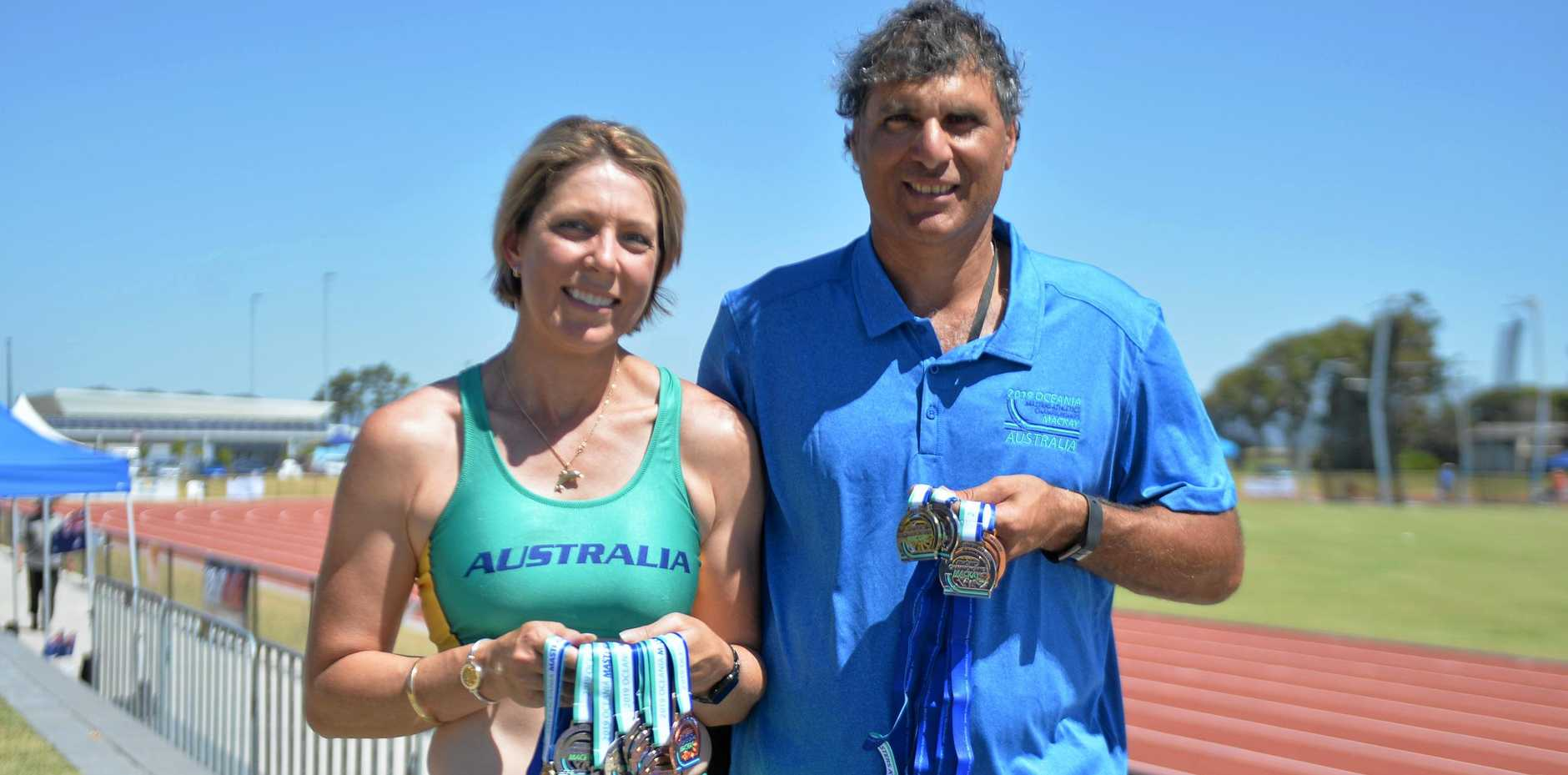 MEDAL HAUL: Mackay competitors in the 2019 Oceania Masters Athletics Championships Les-Lee Reid and Kevin Galea with their medals.
