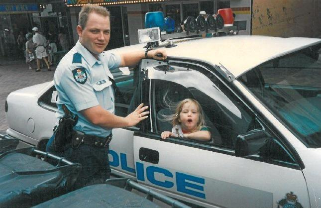 Gatton Police Station's newest recruit Kimberly Allen with Constable Adrian Drysdale, 24 years ago, when she was attracted to the red and blue flashing lights.