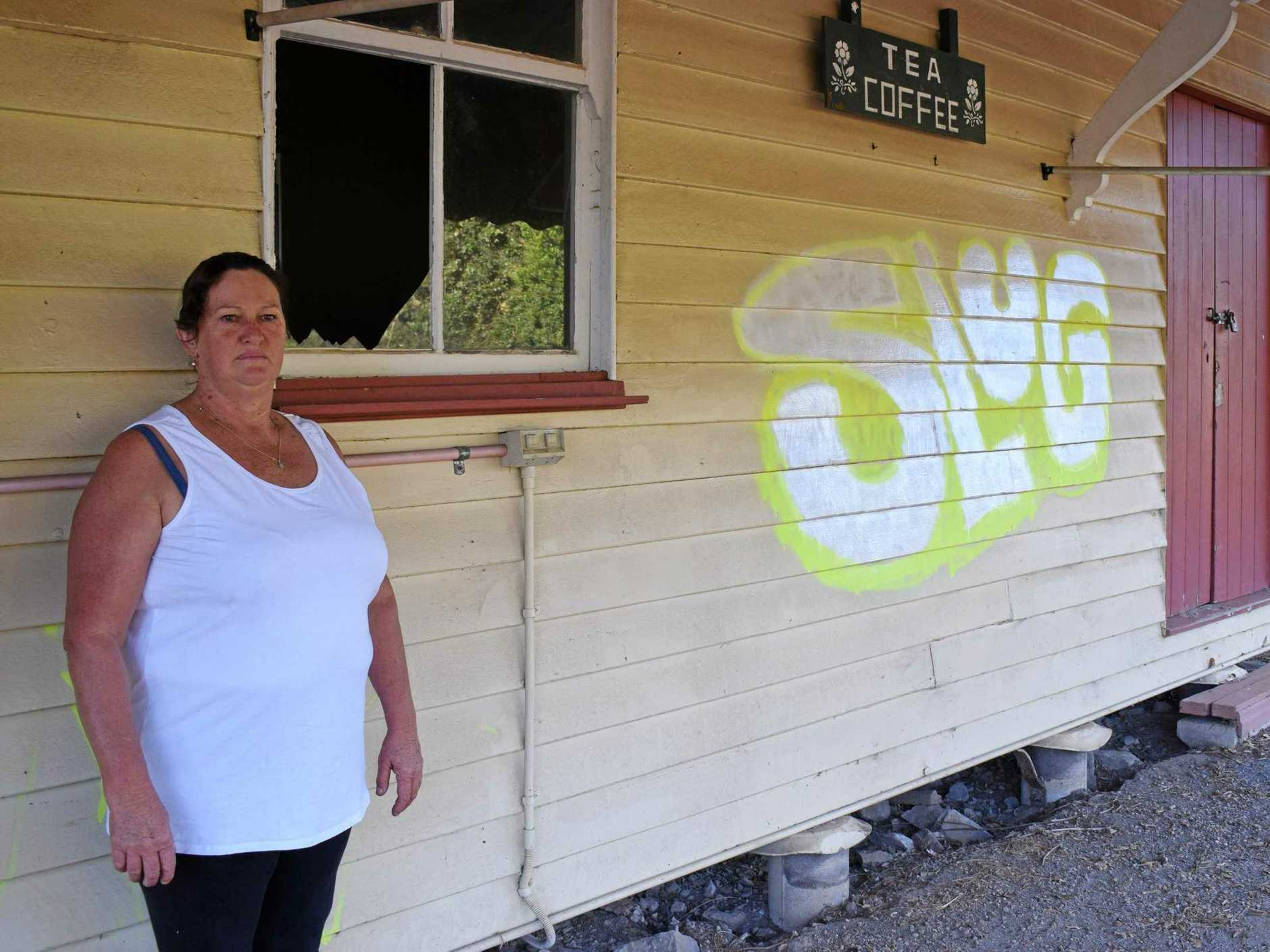 NOT COOL: Disappointed Kandanga community volunteer Michelle Coyle says vandalism at the town's historic railway station is 'not cool in any way, shape or form'.