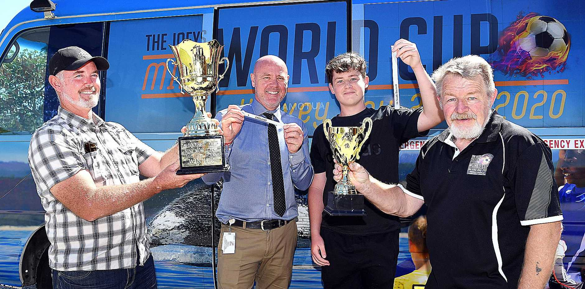 WORLD CUP: Hervey Bay Football president Benjamin Tom, Fraser Coast Deputy Mayor Darren Everard, football player Logan Cowey and Joeys Mini World Cup tournament director Heinrich Haussler at the draw for this year's event.