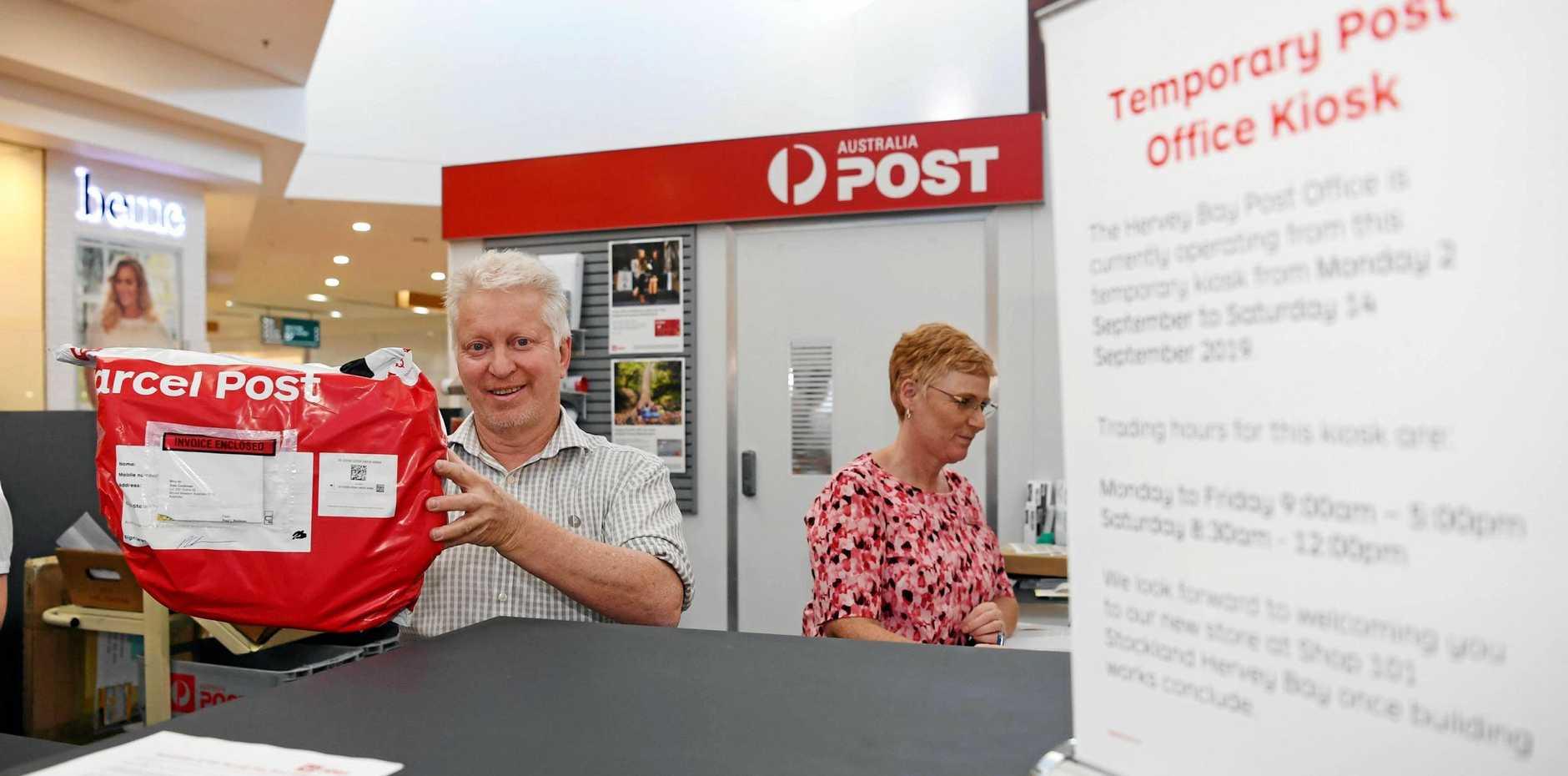 NEW DIGS: Supervisor John Watt gets to work at Australia Post's temporary office inside Stockland Hervey Bay.