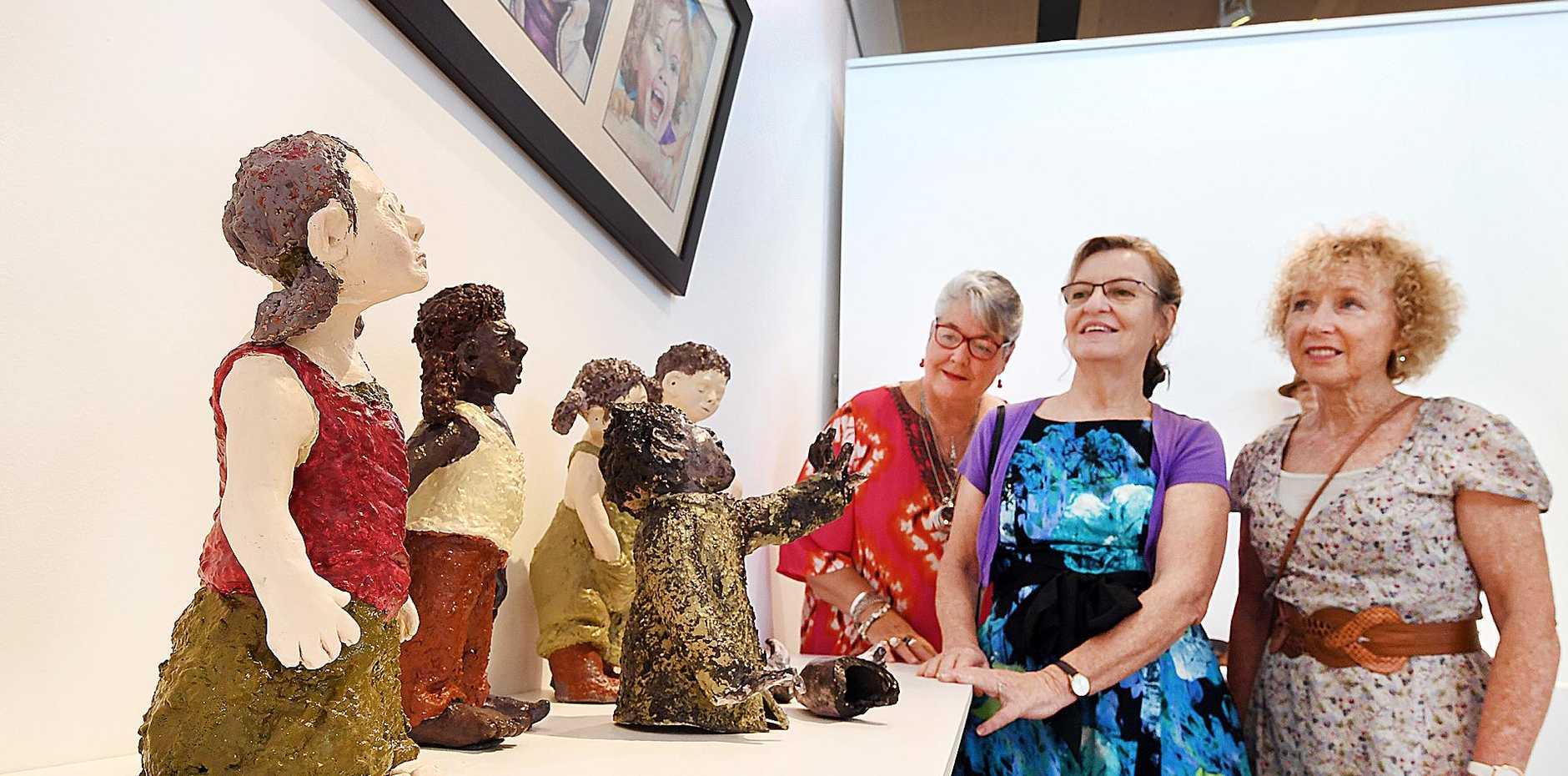 SCULPTURE ON SHOW: Artists Lynn Harris, left, Rachael Brown and Glenda Towan with Rachael's work
