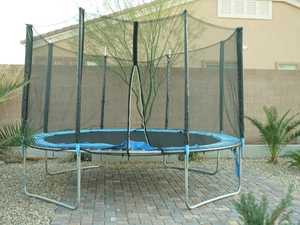 Trampoline spring stuck in boy's back