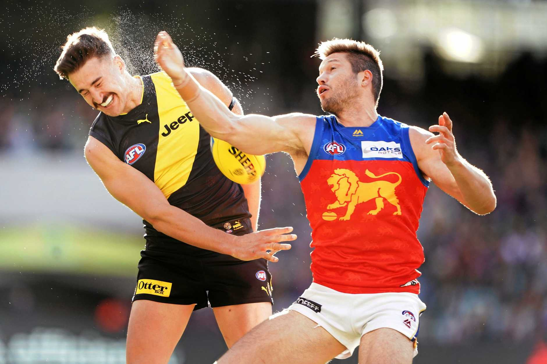 Martin clashes with Tigers rival Ivan Soldo during their round 25 showdown. Photo: Michael Dodge