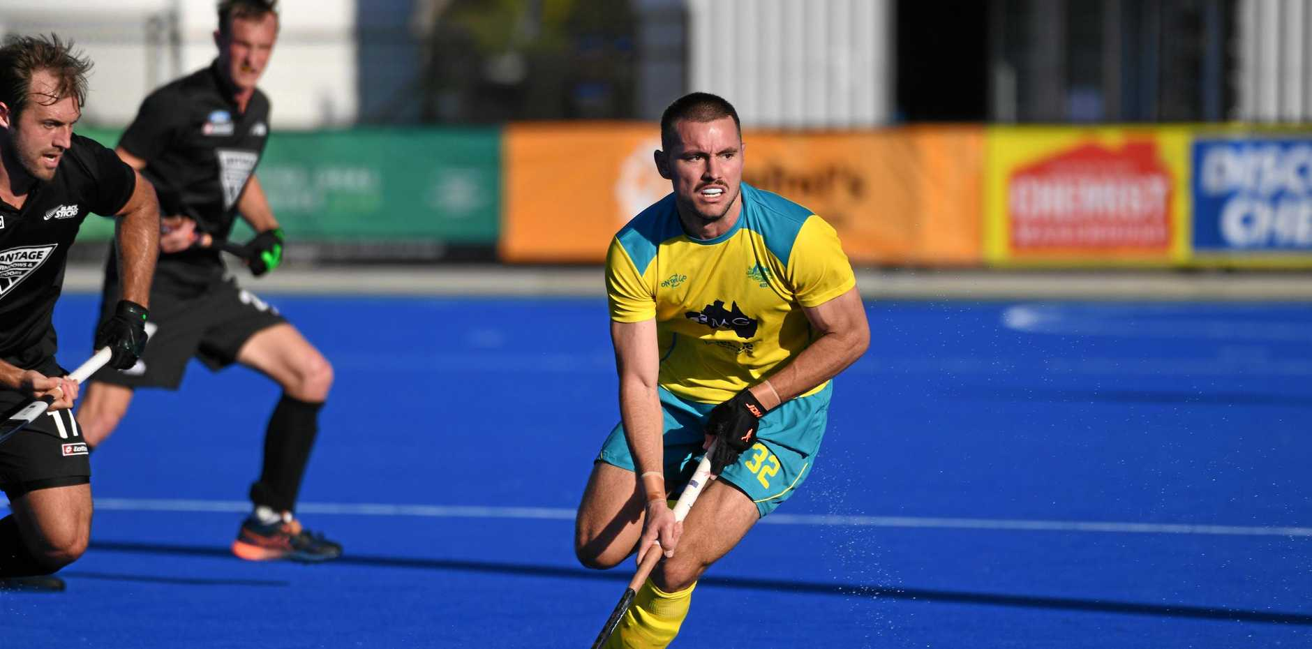 OI OI OI: Australia's man of the match Jeremy Hayward fends of the New Zealand defence at the Oceania Cup.