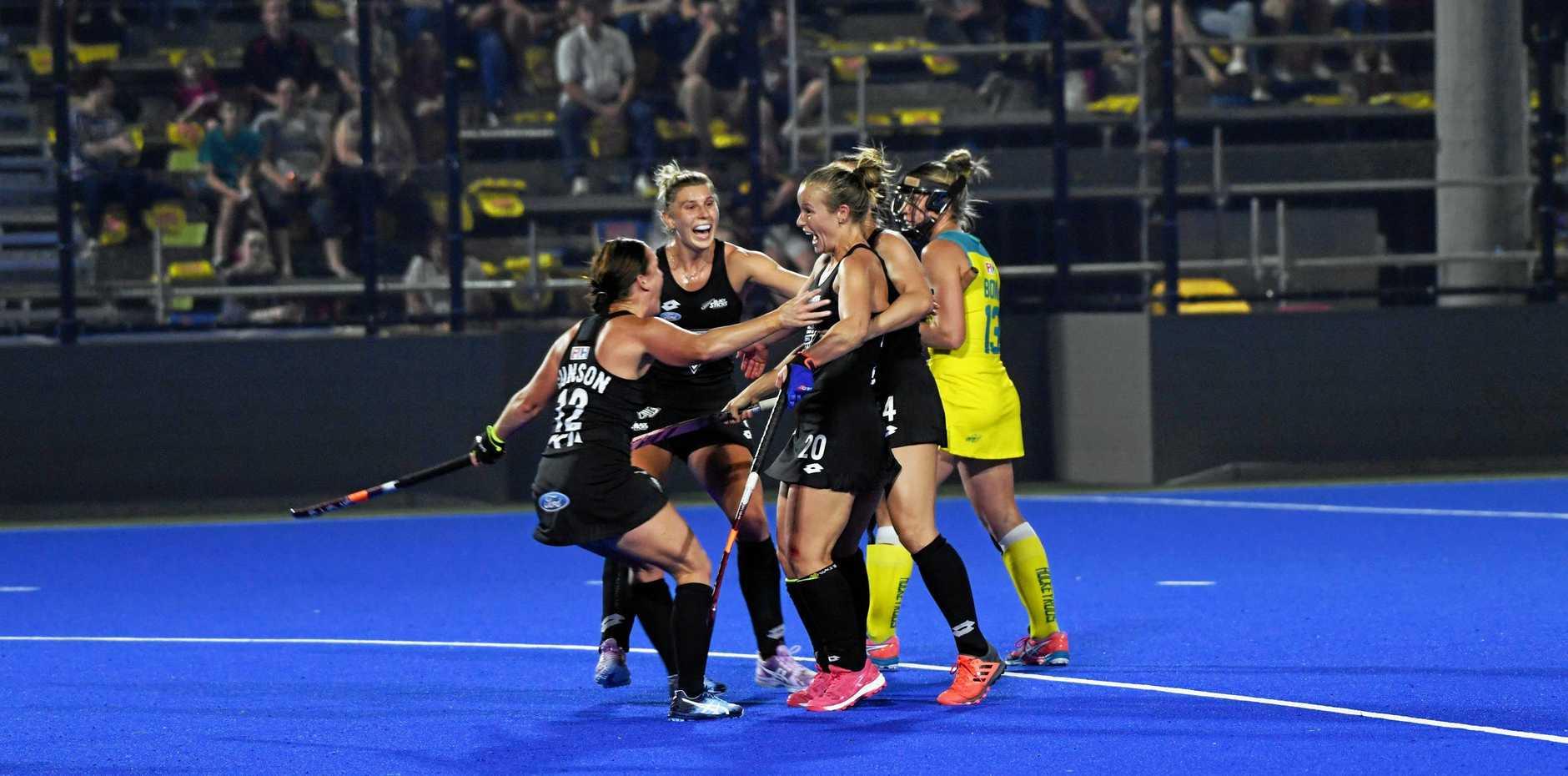 New Zealand celebrate scoring.