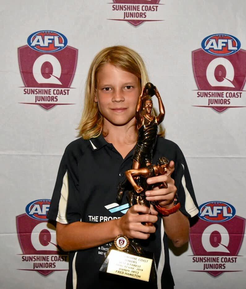 TACKLING THE REST: Gympie Cats under-12s centre Fred Hamilton is ready to rise to the occasion in tomorrow's grand final against Kawana. INSET: Hamilton receiving the trophy as the 2019 AFL Queensland Sunshine Coast juniors best and fairest under 12.