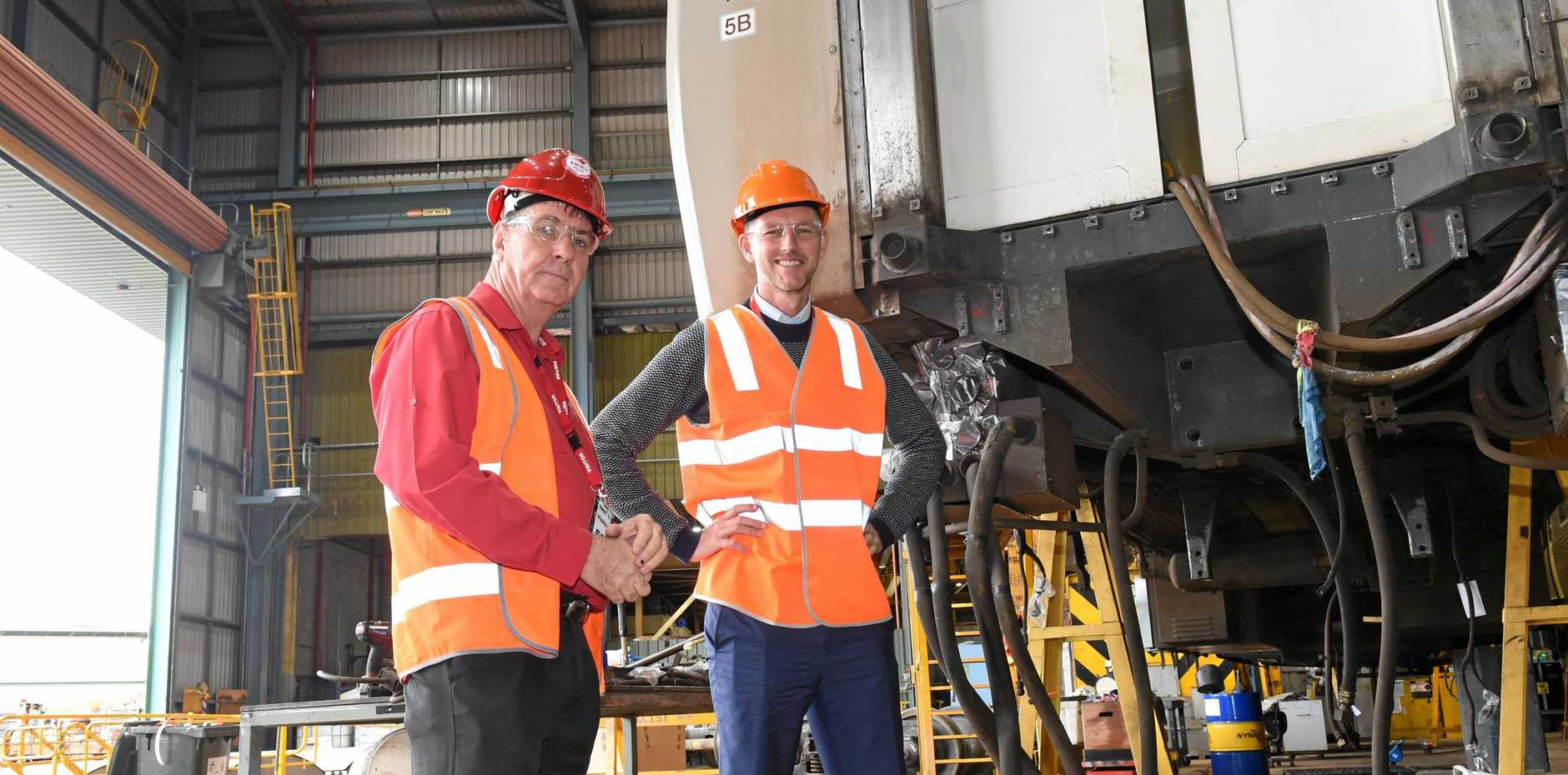 RAIL RALLY: MP Bruce Saunders with transport minister Mark Bailey at Maryborough's Downer factory.