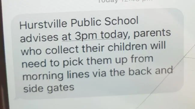 A text sent to parents at Hurstville Public School advising them to pick their children up away from the crime scene at the front gates.Source:news.com.au